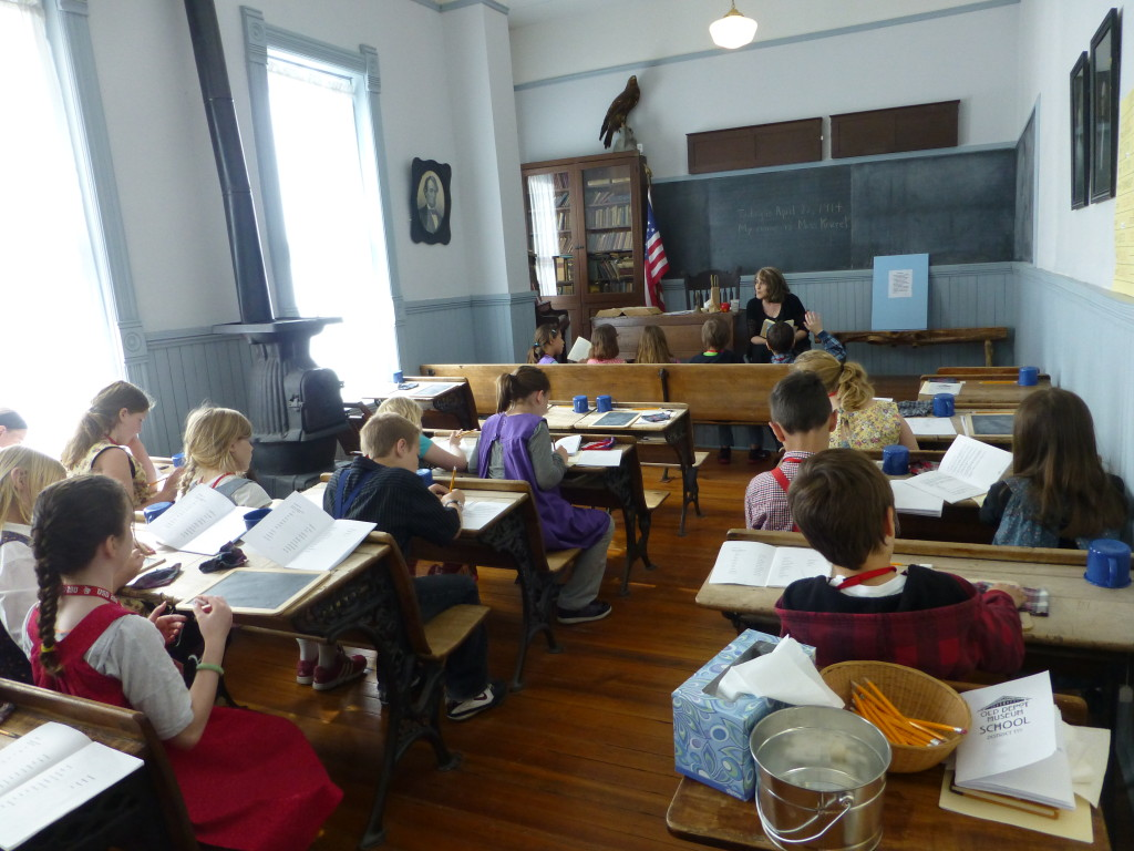 Fourth graders step back in time to experience learning in a one-room school.