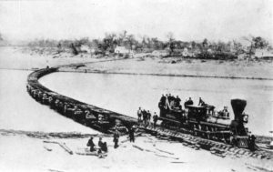 The Leavenworth, Lawrence, and Galveston train crosses a floating bridge.