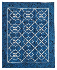 "Vera Anderson's ""Burgoyne in Blue"" is based on a pattern designed to commemorate British General John Burgoyne's surrender during the American Revolution in 1777."