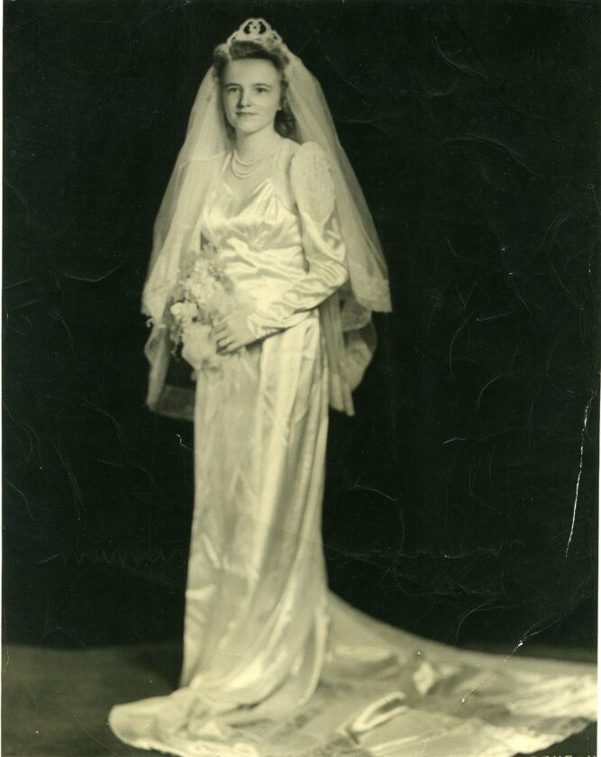 Harma (Peterson) McKenzie on her wedding day in 1945. Her daughter, Karen (McKenzie) McAdoo, would wear this dress at her own wedding in 19